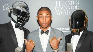 Daft Punk avec Pharrell Williams en juin 2013 à New York.  (BFA/SIPAUSA/SIPA)