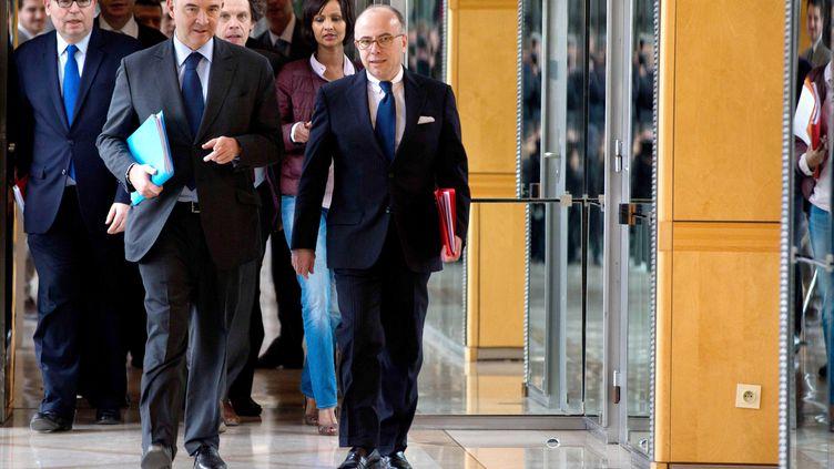 Les ministres de l'Economie, Pierre Moscovici, etdu Budget, Bernard Cazeneuveà Paris, le27 mars 2013. (PRM / SIPA)