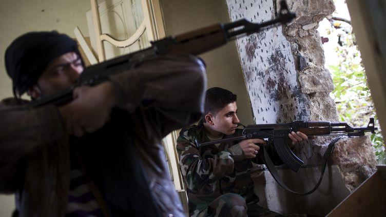Des rebelles syriens à Alep, le 21 décembre 2012. ( AFP )