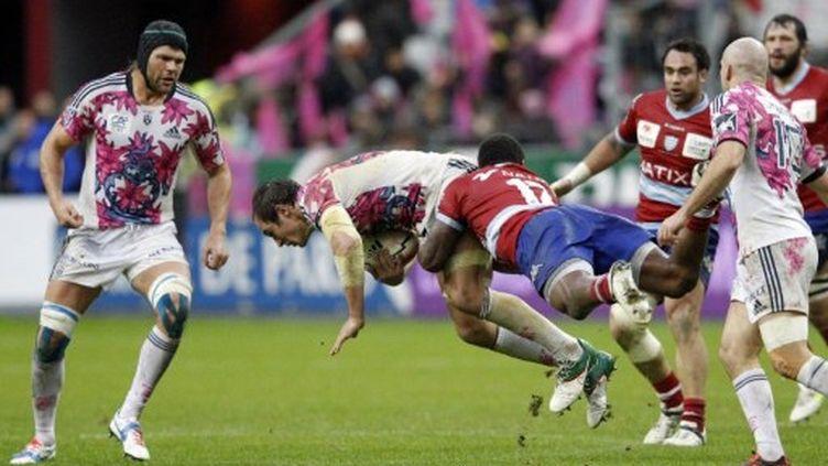 Le derby de Paris entre le Stade Français et le Racing Métro a tourné à l'avantage des partenaires de Sergio Parisse, ici plaqué par Ben Arous