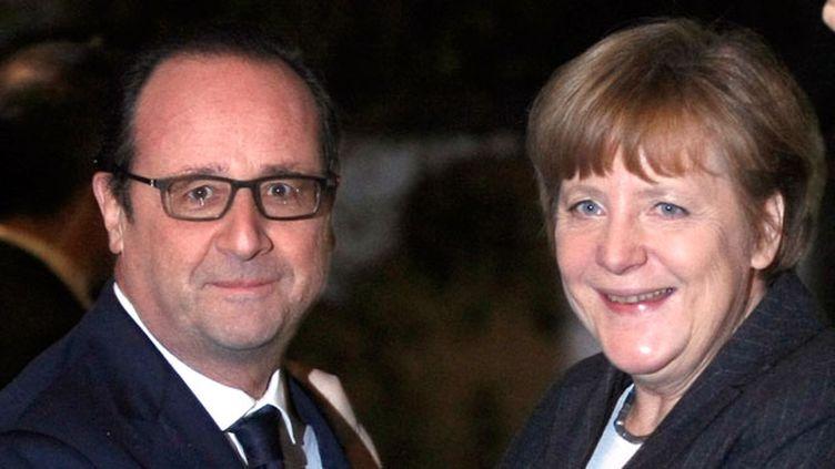 (François Hollande et Angela Merkel tentent ensemble une initiative diplomatique © MAXPPP)