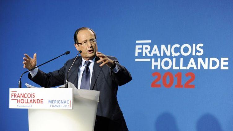 François Hollande, le 4 janvier à Mérignac (Gironde). Il avait été visé par une menace de mort peu avant ce meeting. (JEAN-PIERRE MULLER / AFP)