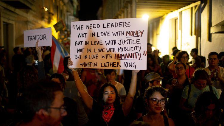 Des manifestants défilent contre le gouvernement après la découverte d'un entrepôt rempli de fournitures non utilisées, à San Juan, le 20 janvier 2020. (JOSE JIMENEZ / GETTY IMAGES NORTH AMERICA)