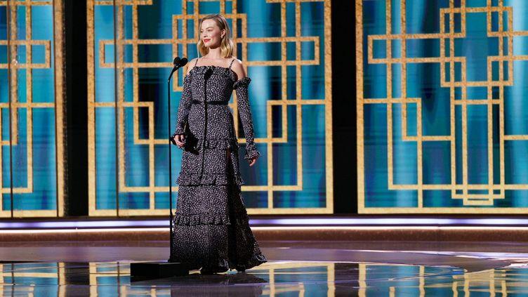 L'actrice Margot Robbie lors de la 78 édition des Golden Globes à Beverly Hills, en Californie (Etats-Unis), le 28 février 2021. (AFP / HFPA)