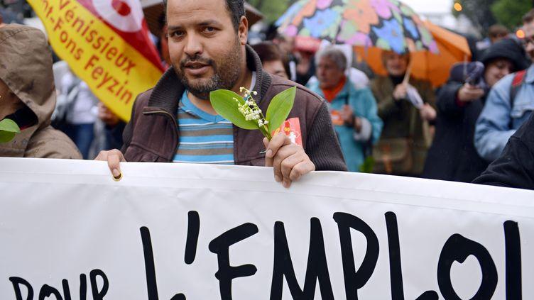 Manifestation à l'occasion de la fête du Travail à Lyon, le 1er mai 2013. (PHILIPPE DESMAZES / AFP)