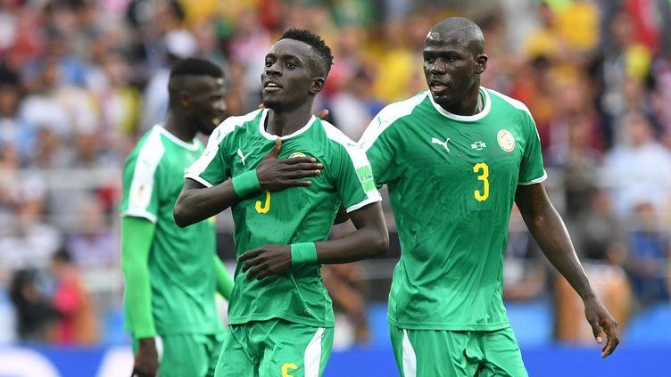 Idrissa Gueye célèbre le but du Sénégal (FRANCISCO LEONG / AFP)