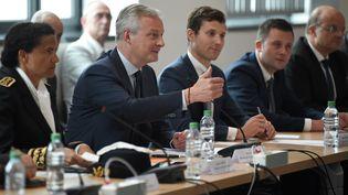 Le ministre de l'Economie Bruno Le Maire, le 3 juin 2019, lors d'une rencontre avec les syndicats de General Electric, à Belfort. (PATRICK HERTZOG / AFP)