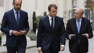 Edouard Philippe, Emmanuel Macron et Gerard Collomb, le 6 septembre 2017, au ministère de l'Intérieur, place Beauvau, à Paris. (FRANCOIS GUILLOT / AFP)