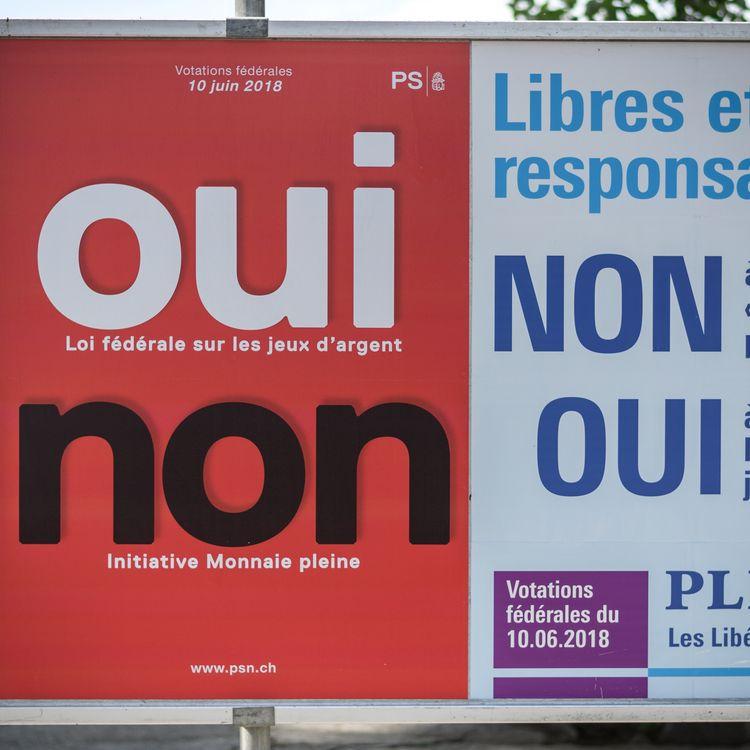 Une affiche électorale lors d'un vote populaire en juin 2018 en Suisse. (FABRICE COFFRINI / AFP)