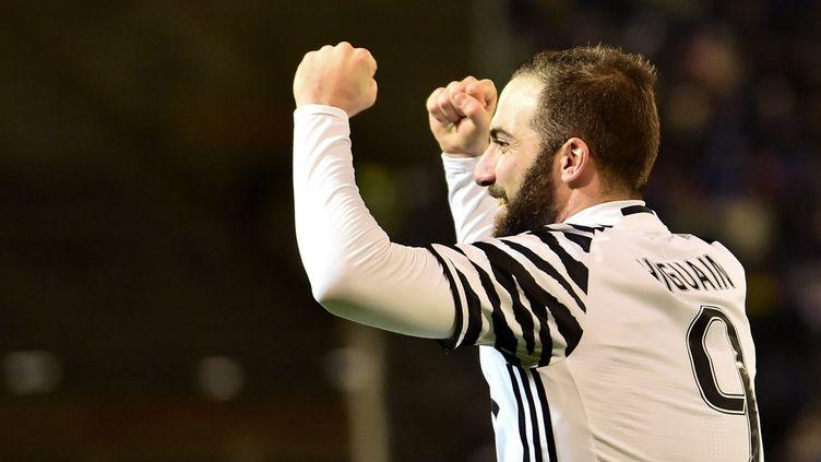 Gonzalo Higuain continue de régaler avec la Juve (GIUSEPPE CACACE / AFP)