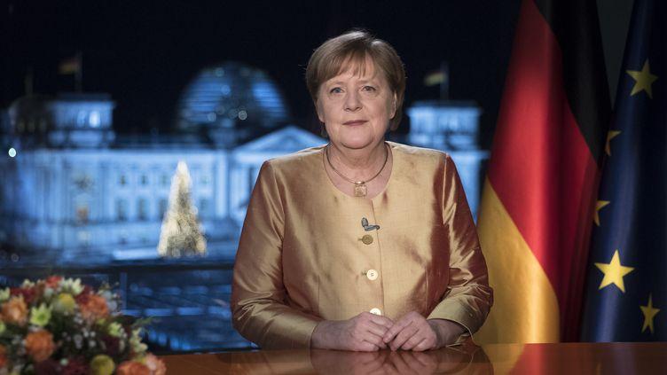 La chancelière allemande, Angela Merkel, lors de ses vœuxdu Nouvel An, retransmis à la télévision le 31 décembre 2020. (MARKUS SCHREIBER / POOL / AFP)