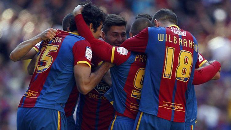 La joie des joueurs de Crystal Palace (IAN KINGTON / AFP)