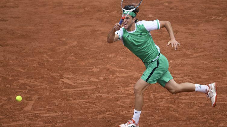 L'Autrichien Dominic Thiem a battu Novak Djokovic en 3 sets. (ERIC FEFERBERG / AFP)