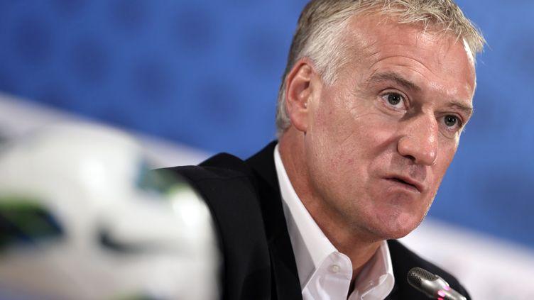 Didier Deschamps annonce la liste des joueurs retenus pour le match France-Uruguay, au siège de la Fédération française de football, à Paris, le 9 août 2012. (KENZO TRIBOUILLARD / AFP)