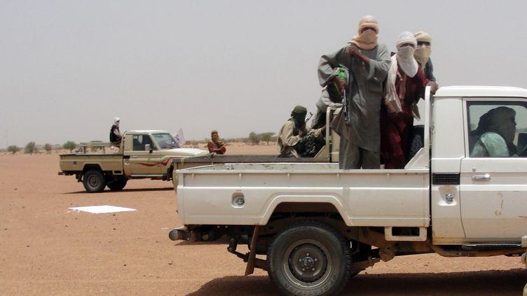 Des combattants d'Ansar Dine à Kidal (Mali), le 7 août 2012. Paris a annoncé que les otages français se trouvaient probablement dans la zone, le 31 janvier 2013. (ROMARIC OLLO HIEN / AFP)