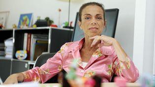 Agnès Saal, présidente de l'INA dans son bureau de Bry-sur-Marne (Val-de-Marne), le 31 juillet 2014. (DOMINIQUE FAGET / AFP)
