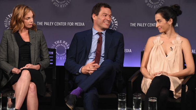 """L'actrice Ruth Wilson (à gauche), son partenaire à l'écran dans """"The Affair"""", Dominic West et Sarah Treem, scénariste principale, le 12 octobre 2015, à New York. (NICHOLAS HUNT / GETTY IMAGES NORTH AMERICA / AFP)"""