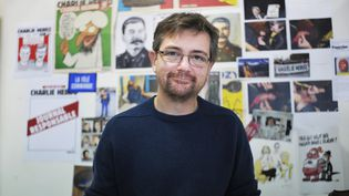 Charb dans son bureau de Charlie Hebdo.  (Richard Brunel / La Montagne / MaxPPP)