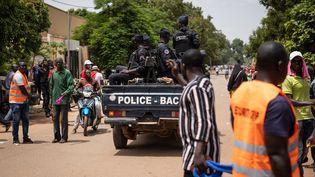 Marche de l'opposition burkinabè à Ouagadougou, le 3 juillet 2021, pour protester contre l'aggravation de la situation sécuritaire et demander une réponse aux attaques jihadistes. (OLYMPIA DE MAISMONT / AFP)