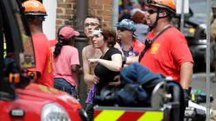 Une femme blessée, après qu'une voiture a foncé sur la foule à Charlottesville (Virginie), le 12 août 2017. (JOSHUA ROBERTS / REUTERS)