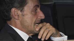 Nicolas Sarkozy quittant sur bureau parisien en voiture, le 19 septembre 2014. (JOEL SAGET / AFP)