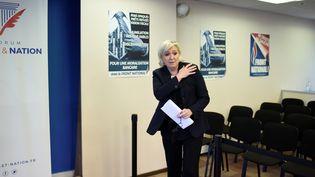 Marine Le Pen, au siège du Front national à Nanterre (Hauts-de-Seine), le 8 décembre 2017. (STEPHANE DE SAKUTIN / AFP)