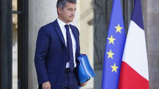 Le ministre de l'Intérieur, Gérald Darmanin, quitte l'Elysée, le 22 septembre 2021, après un Conseil des ministres. (THOMAS SAMSON / AFP)