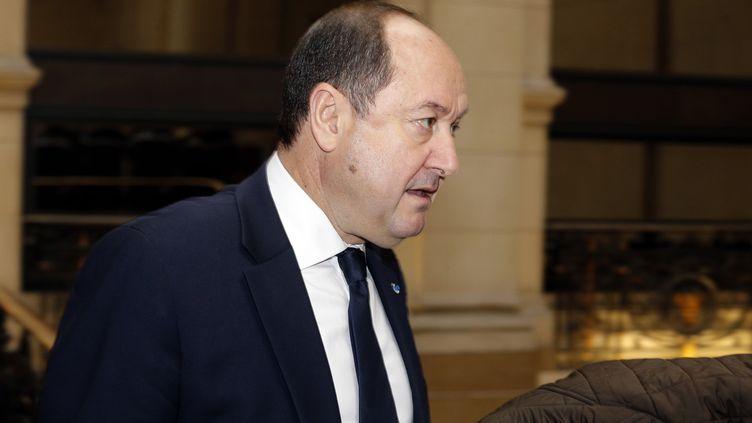 Bernard Squarcini, l'ancien patron du renseignement intérieur, arrive au tribunal, à Paris, le 18 février 2014. (FRANCOIS GUILLOT / AFP)