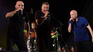 Mouss, Majid, et Hakim du groupe Zebda, en concert à Tunis en juin 2014  (FETHI BELAID / AFP)