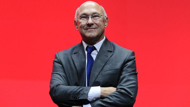 Michel Sapin, ministre du travail, le24 septembre 2013, à Bordeaux. (NICOLAS TUCAT / AFP)