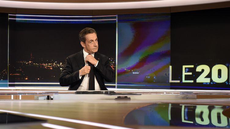 Nicolas Sarkozy sur le plateau du journal de TF1, dimanche 30 novembre 2014, après son élection à la présidence de l'UMP. (MARTIN BUREAU / POOL / AFP PHOTO)