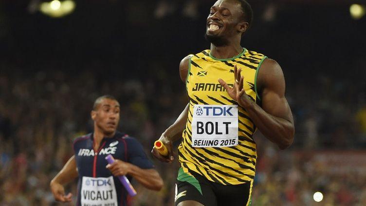 Usain Bolt heureux, Jimmy Vicaut perdu derrière lui (OLIVIER MORIN / AFP)