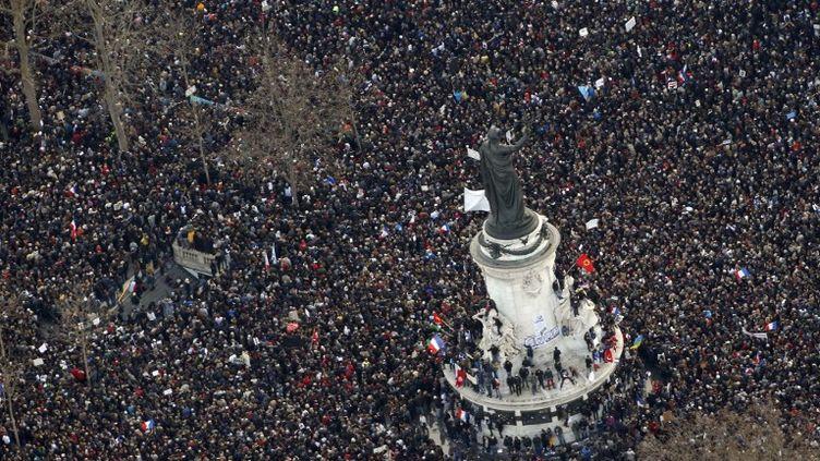 """""""Marche républicaine"""" à Paris le 11 janvier 2015 après les attaques contre Charlie Hebdo. (KENZO TRIBOUILLARD / AFP)"""