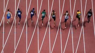 La finale du 100m hommes lors des Mondiaux de Doha, le 28 septembre 2019. (JEWEL SAMAD / AFP)