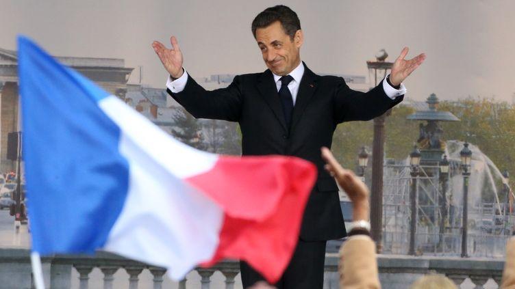 Nicolas Sarkozy en meeting à la Concorde, àParis, le 15 avril 2012. (KENZO TRIBOUILLARD / AFP)