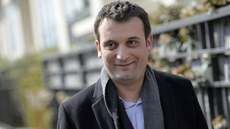 Florian Philippot,vice-président du Front national, le 24 mars 2014 à Nanterre (Hauts-de-Seine).Il est arrivé en tête lors du premier tour des élections municipalesà Forbach (Moselle), où il est candidat. (MIGUEL MEDINA / AFP)