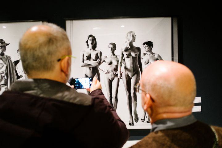 """Visitors in front of the famous series of photos """"Naked and Dressed"""" by Helmut Newton at an exhibition in Naples in 2017 (ELIANO IMPERATO / CONTROLUCE)"""