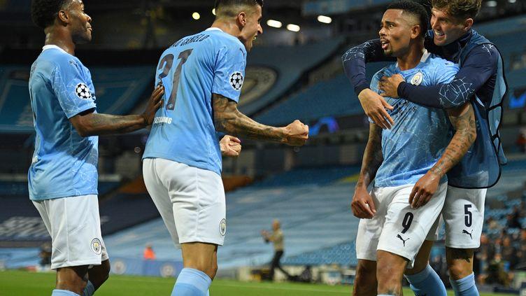 Suite à une nouvelle bourde de Varane, Gabriel Jesus en a profité pour permettre à Manchester City de filer tout droit en quarts de finale. (OLI SCARFF / POOL)