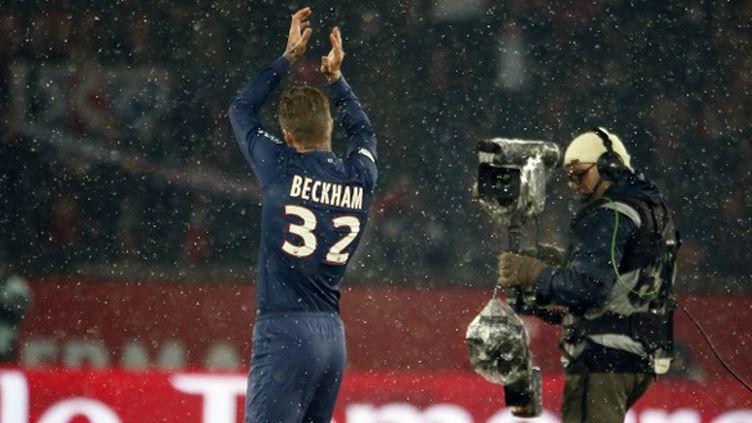 En janvier 2013, Beckham s'offre un dernier challenge et signe au PSG, où il échoue en Ligue des Champions face au Barça mais remporte le titre de champion de France. C'est son dernier trophée : le jeudi 16 mai, à l'âge de 38 ans, il annonce la fin de sa carrière. (KENZO TRIBOUILLARD / AFP)