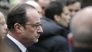 """François Hollande, mercredi 7 janvier 2014 devant les locaux de """"Charlie Hebdo"""", à Paris. (KENZO TRIBOUILLARD / AFP)"""