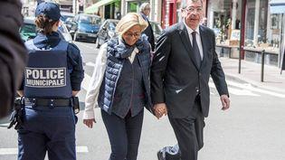 Isabelle et Patrick Balkany, aux obsèques de la chanteuse Patachou, à Levallois-Perret (Hauts-de-Saine), le 7 mai 2015. (CITIZENSIDE / YANN KORBI / AFP)
