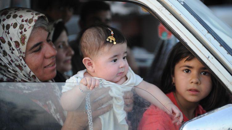 Des milliers de chrétiens trouvent refuge à Erbil (Irak), après une nouvelle progression des jihadistes,le 6 août 2014. (MUSTAFA KERIM / ANADOLU AGENCY / AFP)