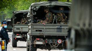 D'importants moyens militairessont mobilisés à Maasmechelen,le 21 mai 2021,dans le parc où aurait disparu le fugitif Jürgen Conings. (ROB ENGELAAR / ANP MAG / AFP)