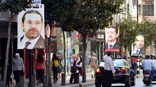 Les portraits en soutienau Premier ministre libanais Saad Hariri affichés dans les rues de Beyrouth. (WAEL HAMZEH / EPA)