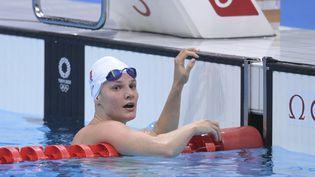 La Française Marie Wattel s'est qualifiée avec brio pour la finale du 100 mètres papillon, dimanche 25 juillet. (KEMPINAIRE STEPHANE / AFP)
