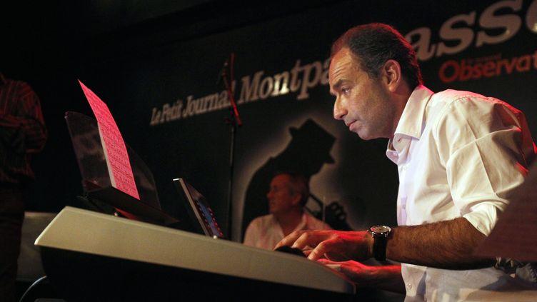 La passion de Jean-François Copé pour le piano a inspiré un poisson d'avril à Rue 89. (JOEL SAGET / AFP)