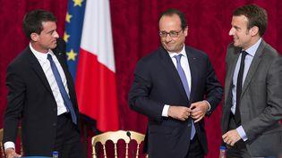 Manuel Valls, François Hollande et Emmanuel Macron, le 16 juin 2015 à l'Elysée. (LIONEL BONAVENTURE / AFP)