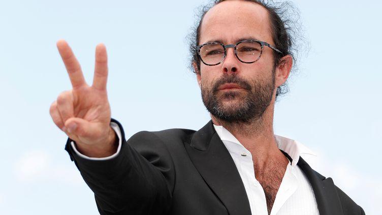 Cédric Herrou, lors de son passage au festival de Cannes, le 18 mai 2018. (IAN LANGSDON / EPA)