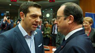 Alexis Tsipras et François Hollande, le 12 février 2015,à Bruxelles (Belgique). (COUNCIL OF EUROPE / ANADOLU AGENCY / AFP)