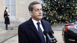Nicolas Sarkozy sur le perron de l'Elysée après une rencontre avec le président de la République François Hollande, le 8 janvier 2015. (THIERRY CHESNOT / GETTY IMAGES NORTH AMERICA / AFP)
